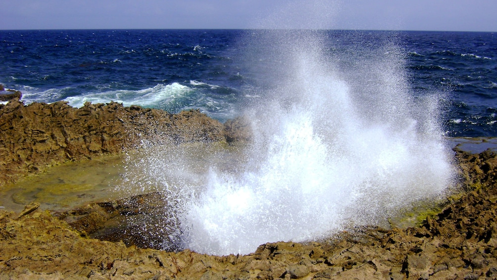 Show item 4 of 5. Waves splash inland in Curacao
