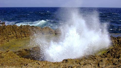 Waves splash inland in Curacao