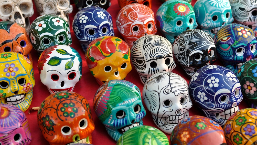 Colorful hand painted skulls at a market