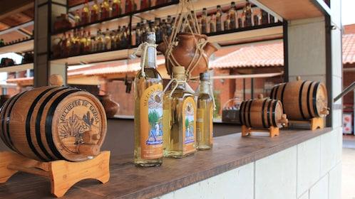 Bottles and small barrels of Mezcal Mexican liquor