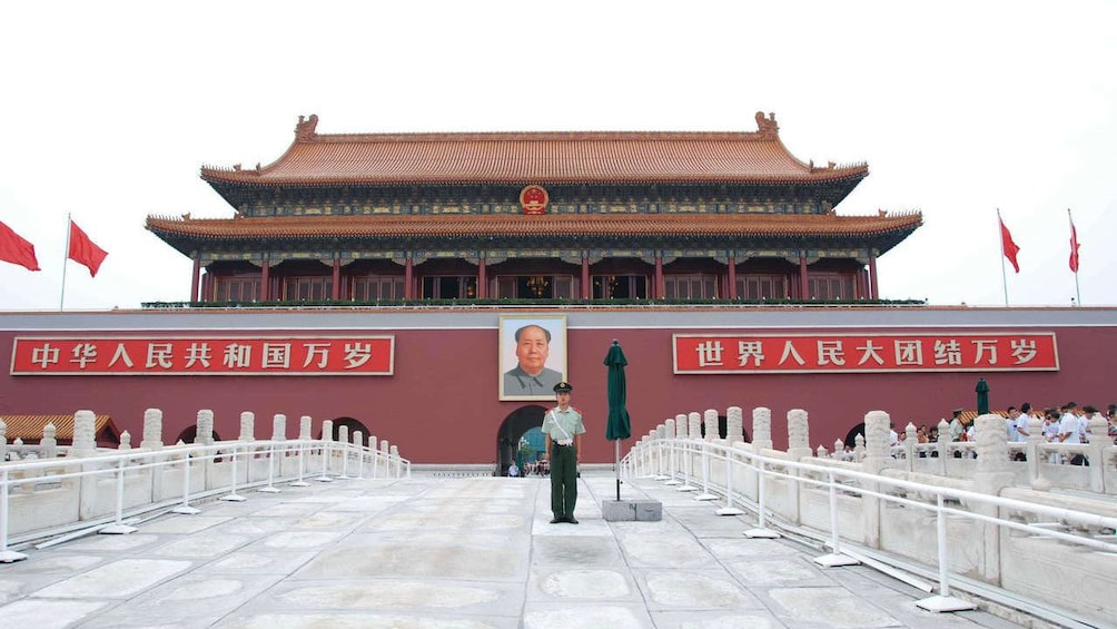 Show item 4 of 10. Guard at the entrance of Tiananmen Square in China