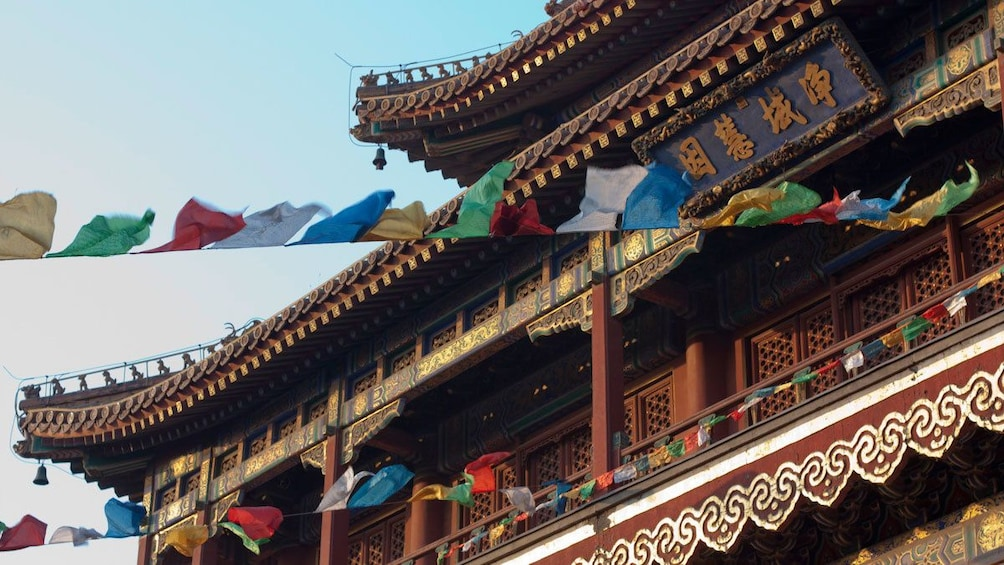 Show item 3 of 5. Colorful flags streamed from The Yonghe Temple in Beijing
