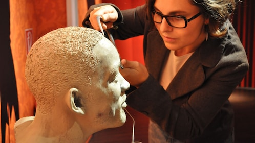 woman working on will smiths head