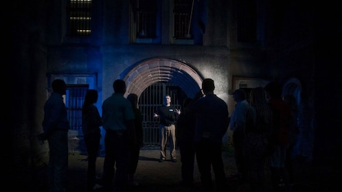 Tour group outside a haunted building in Charleston at night