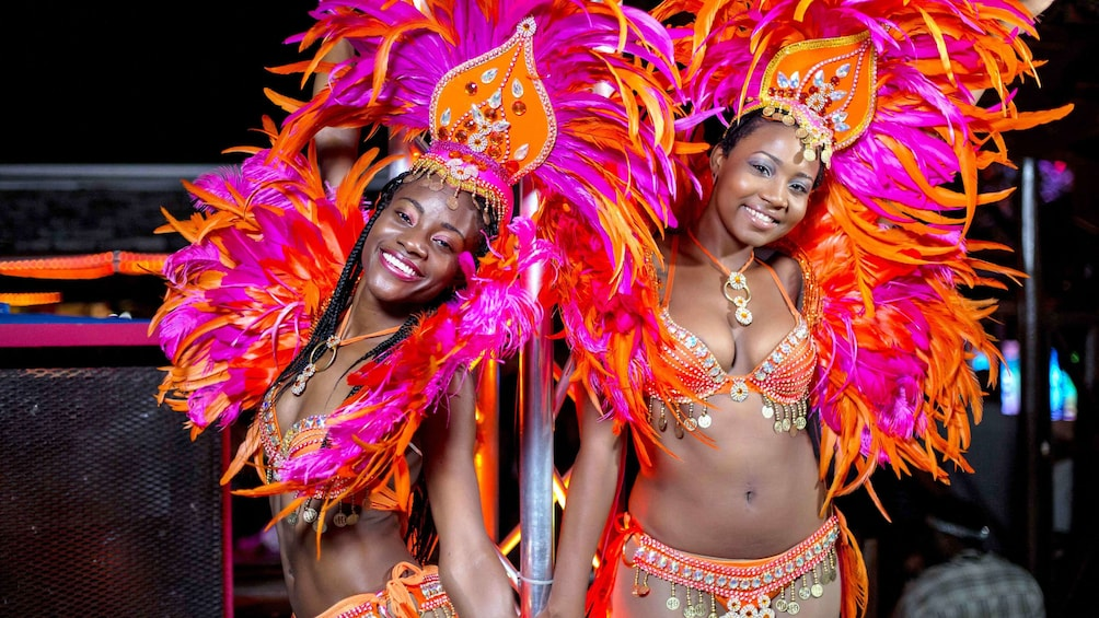 Show item 1 of 6. Performers in colorful costumes in Barbados