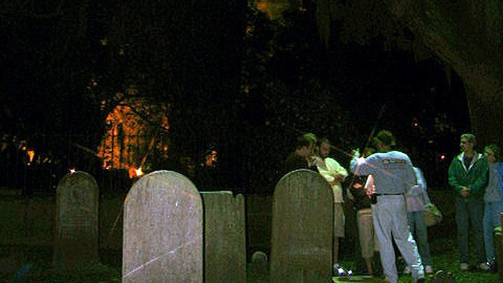 Tour group in a graveyard at night in Charleston