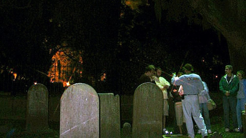 Show item 9 of 9. Tour group in a graveyard at night in Charleston