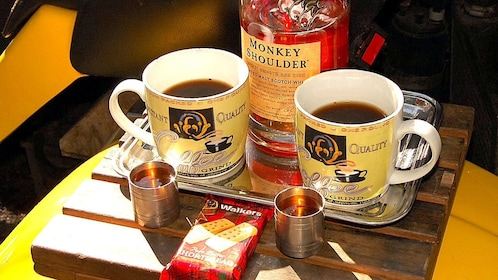 Coffee and cookies on tray in