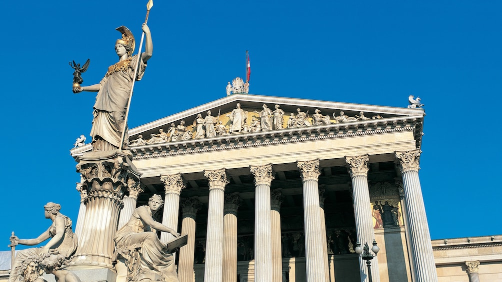 Show item 3 of 4. Statue and pillars of the facade of the Parliament Building in Vienna