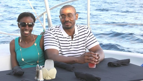 Couple having a drink on the sailboat in Grand Cayman