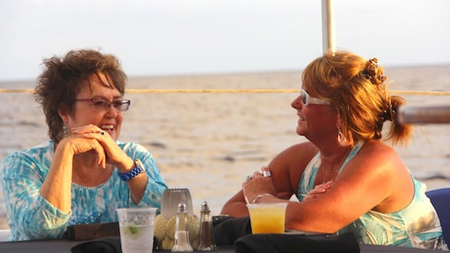 Having drinks in the sunset at Grand Cayman