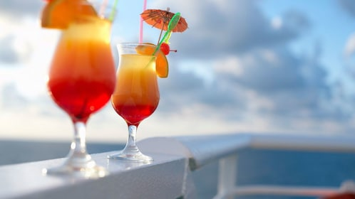 Enjoying beverages in the sunset in Grand Cayman