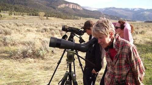 People looking into telescopes at Grand Teton National Park