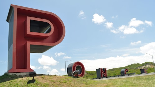 Outdoor sculpture of giant letters spelling PONCE