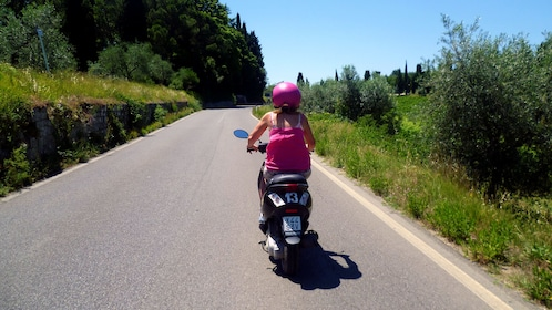 Girl on Road on Tuscany by Vespa tour in Italy