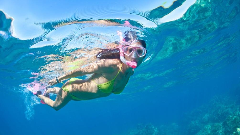 Single female snorkeler in the ocean off the coast of Puerto Rico