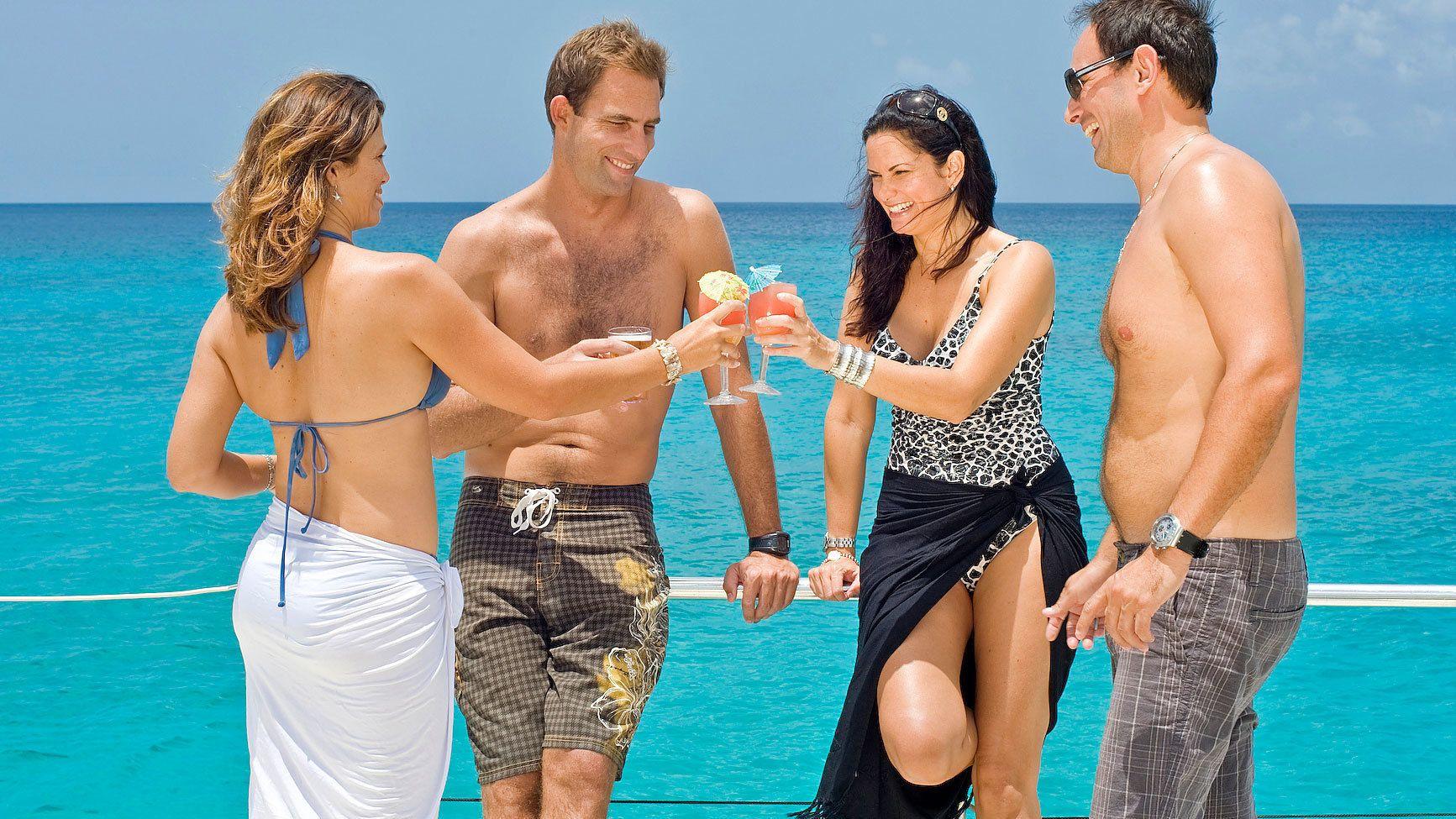 Friends enjoying drinks on cruise in barbados