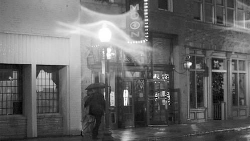 People walking in the rain at night in Memphis