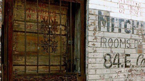 Boarded up vacant building during ghost tour in Memphis