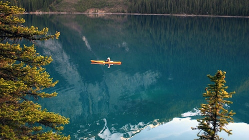 Kayaker paddling on Medicine Lake