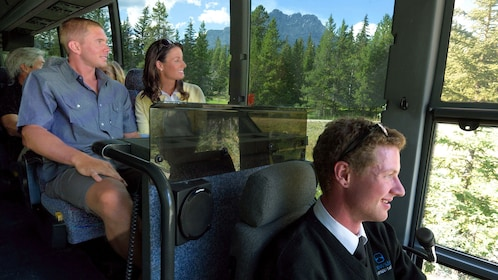 Guests enjoying the views of Jasper National Park from the windows of the tour bus