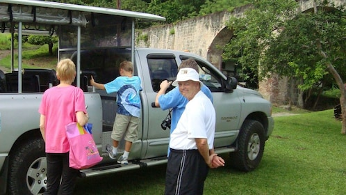Tour group boarding a truck in St Lucia