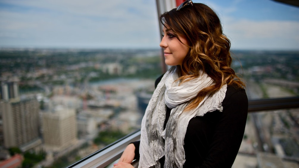 Show item 3 of 5. Woman at the Calgary tower observation deck