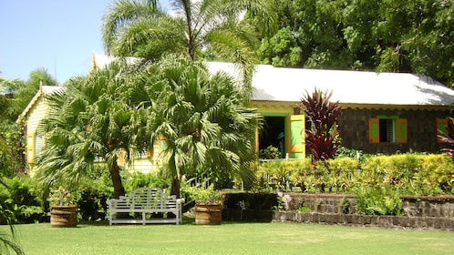 Colorful and historical Romney Manor and surrounding greenery in St Kitts