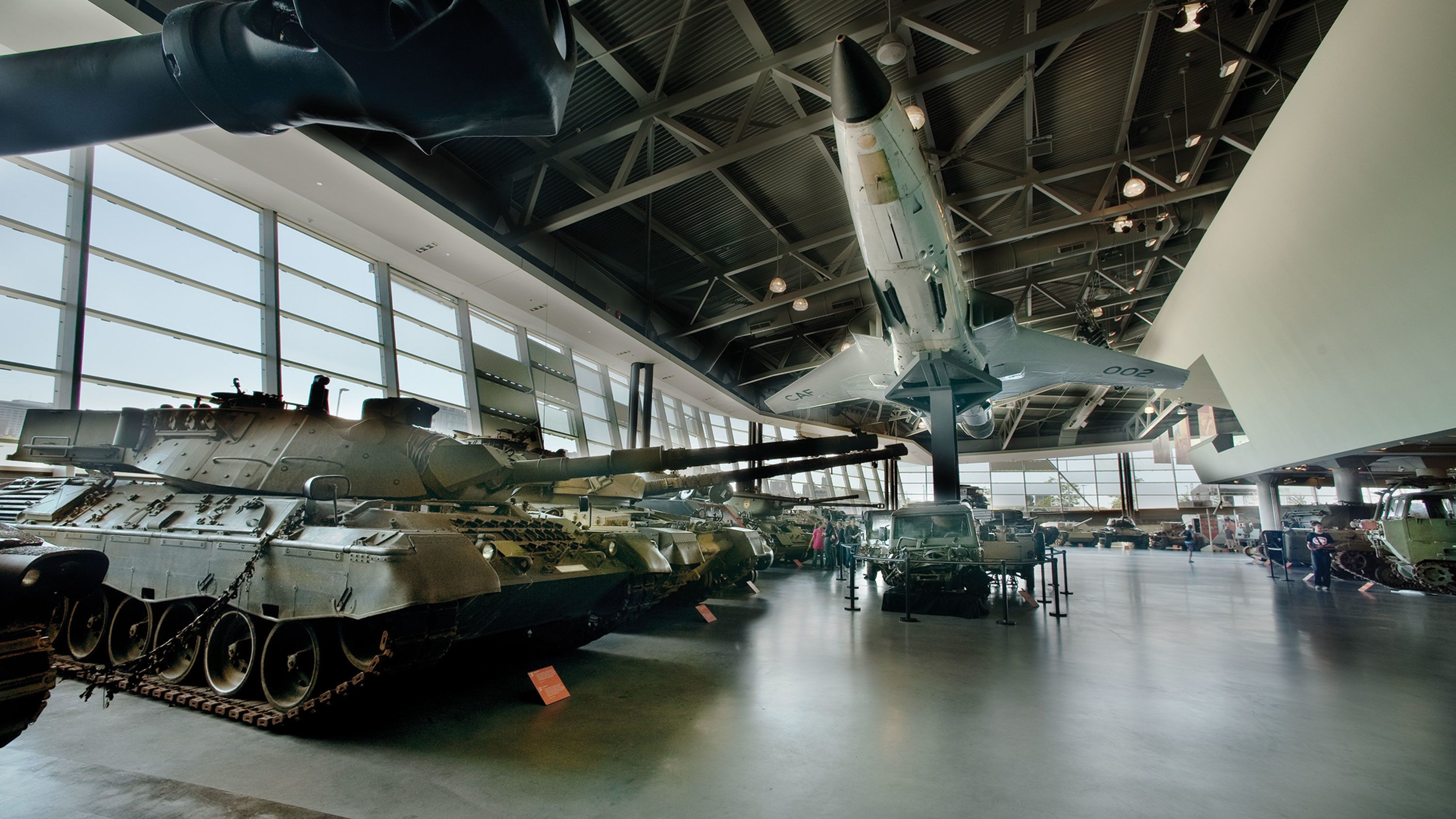 Plane suspended above military tanks and vehicles at the Canadian War Museum in Ottawa