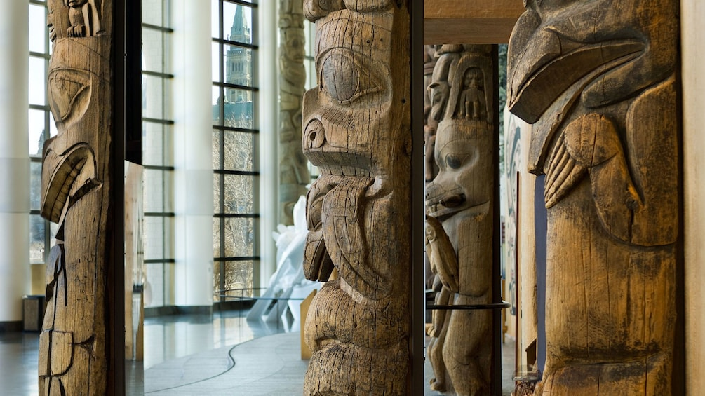 Show item 1 of 10. Large totem poles in the Grand Hall at the Canadian Museum of Civilization in Ottawa