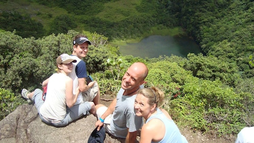 Hiking group sitting on top of Mount Liamuiga volcano in St Kitts