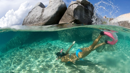 Snorkeling woman dives under the surface in St Kitts