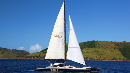 Catamaran sailboat in the water with St Kitts in the background