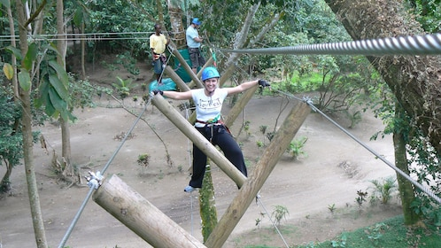 Woman smiling as she enjoys the adventure course at the Wacky Rollers Adventure Park