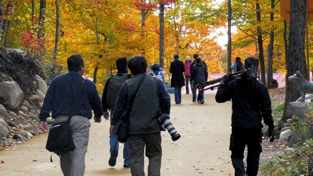 Tourists embark on Canyon Sainte-Anne to take photos of the fall foliage