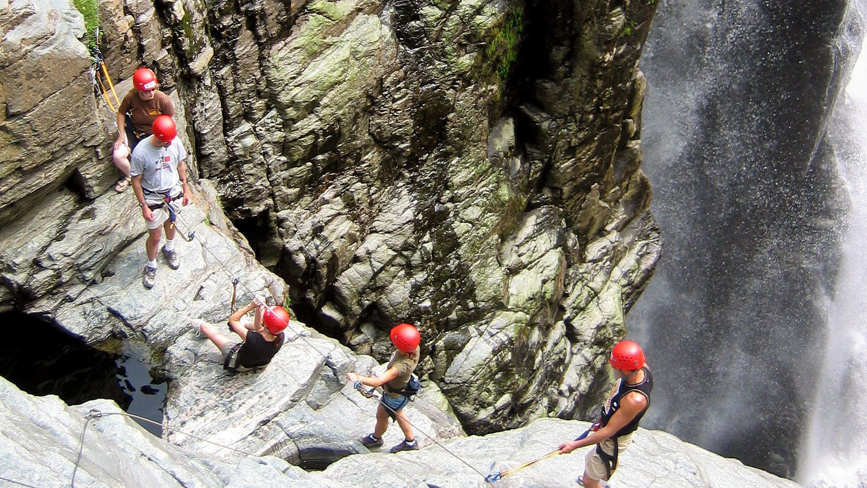 Hikers traversing the rocks of Canyon Sainte-Anne