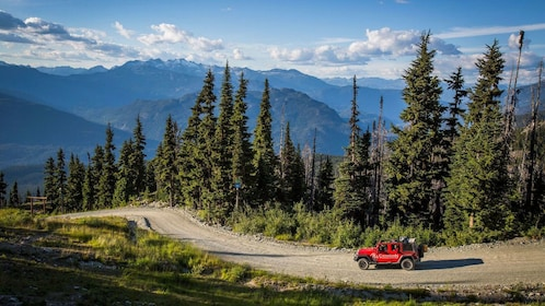 Jeep driving up mountain pass in Whistler