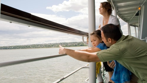 Family sightseeing onboard the Louis Jolliet river boat touring through the Saint Lawrence River