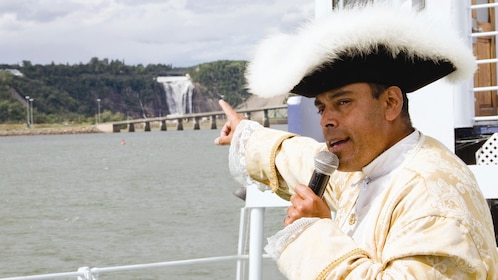 Tour guide showcasing the sights and sounds of Quebec City to guests onboard the Louis Jolliet