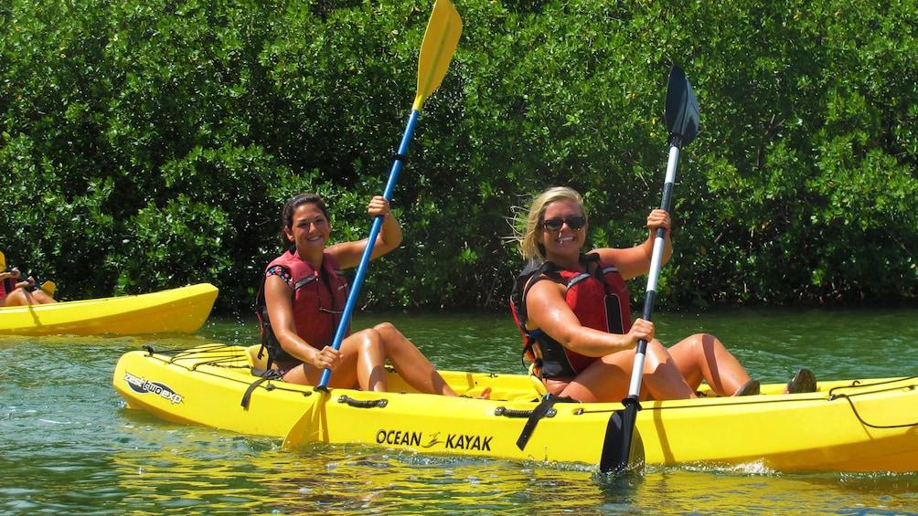 Show item 1 of 5. Women ride tandem on a kayak around St. Thomas
