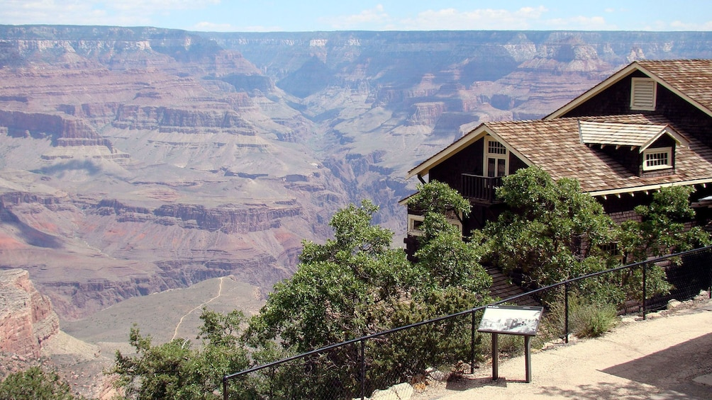 Show item 5 of 5. Post overlooking the Grand Canyon