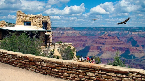 View of a tour group enjoying a view of the Grand Canyon
