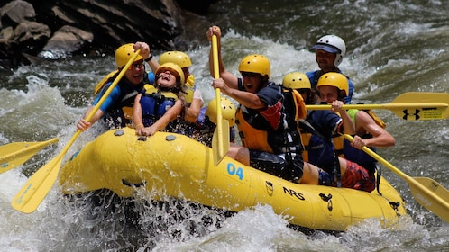 Group enjoying the rapids during Pigeon River whitewater rafting trip in Tennessee
