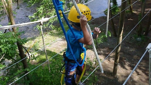 Child walking through a ropes course in the heart of the Smokey Mountains