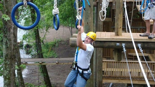 Man going through a ropes course in the heart of the Smokey Mountains