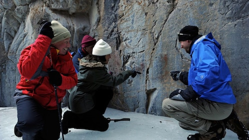 Guide describing rock formations to his guests within Grotto Canyon