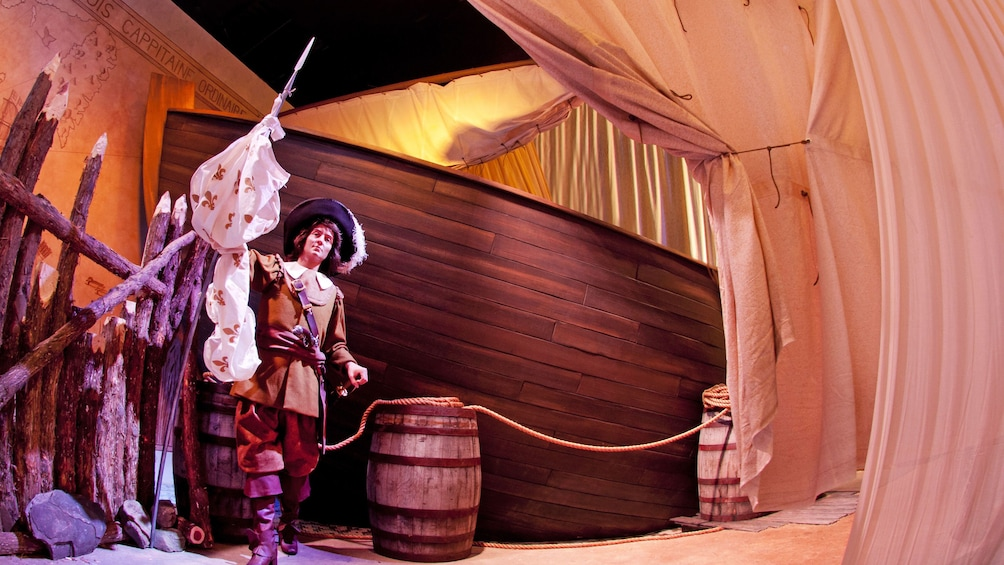 Wax statue set with a Pirate standing next to barrels and pikes