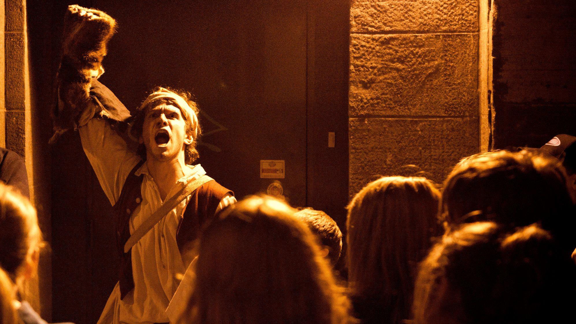 Tour guide imitating werewolf on Old Montreal Ghosts & Spirits Walking Tour