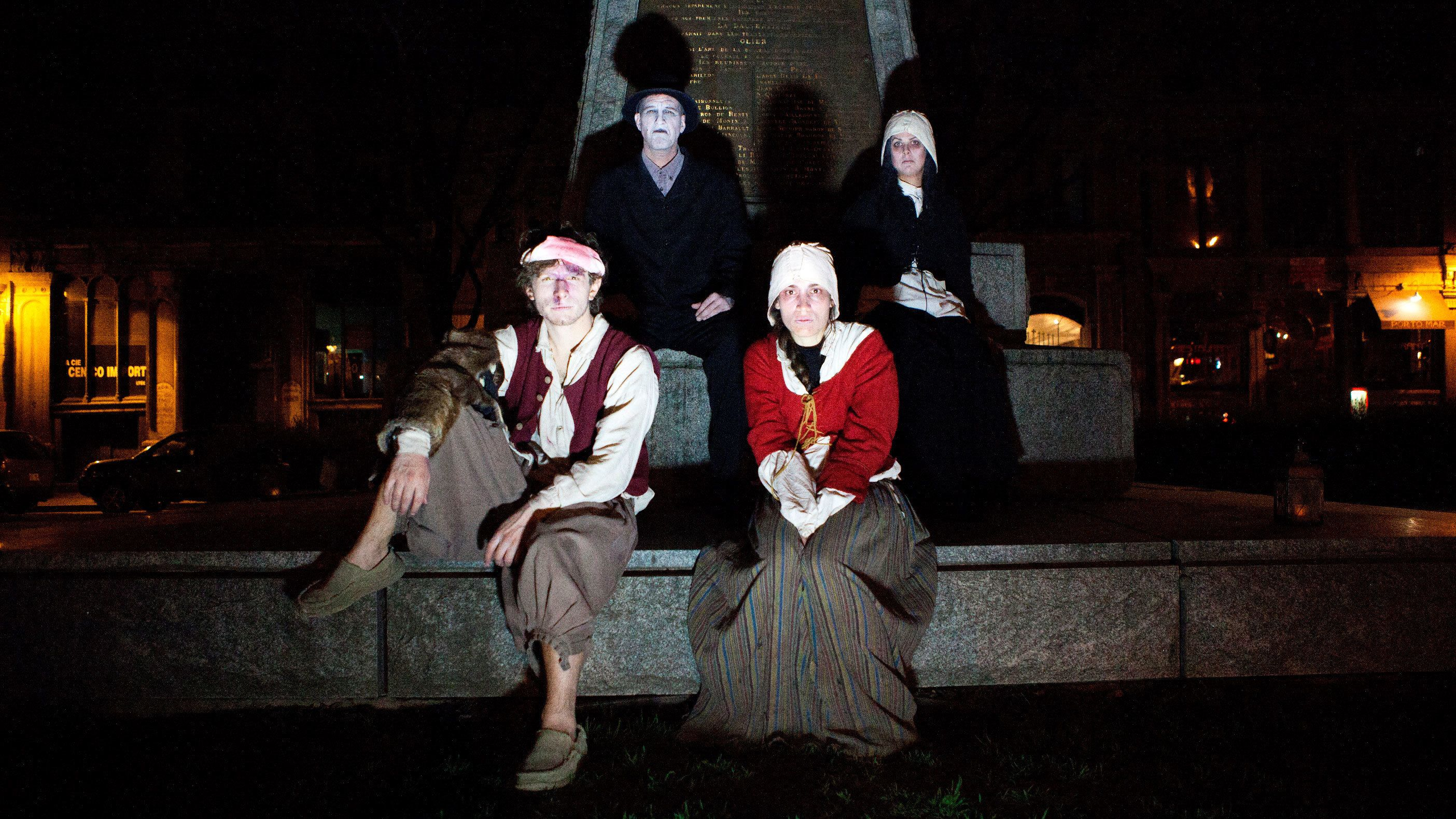 actors dressed in 1880s clothing cast scary shadows in Old Montreal Ghosts & Spirits Walking Tour