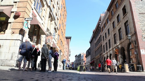 Wide, street view of cobblestone streets of Old Montreal